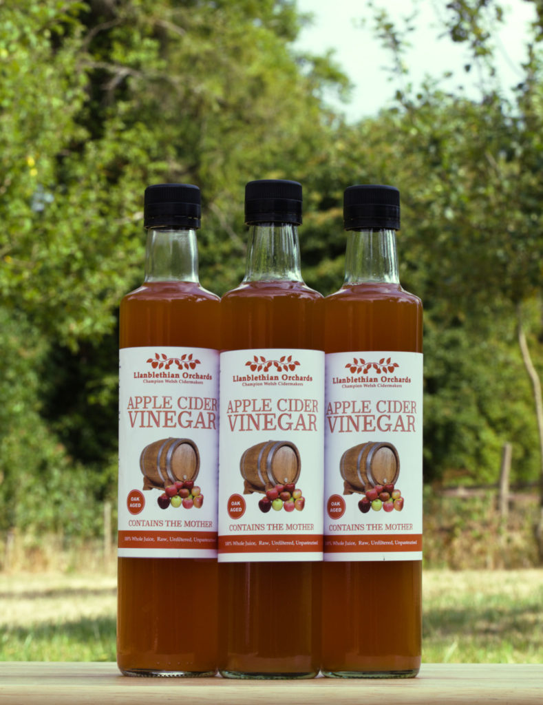 Cider vinegar three bottles close up