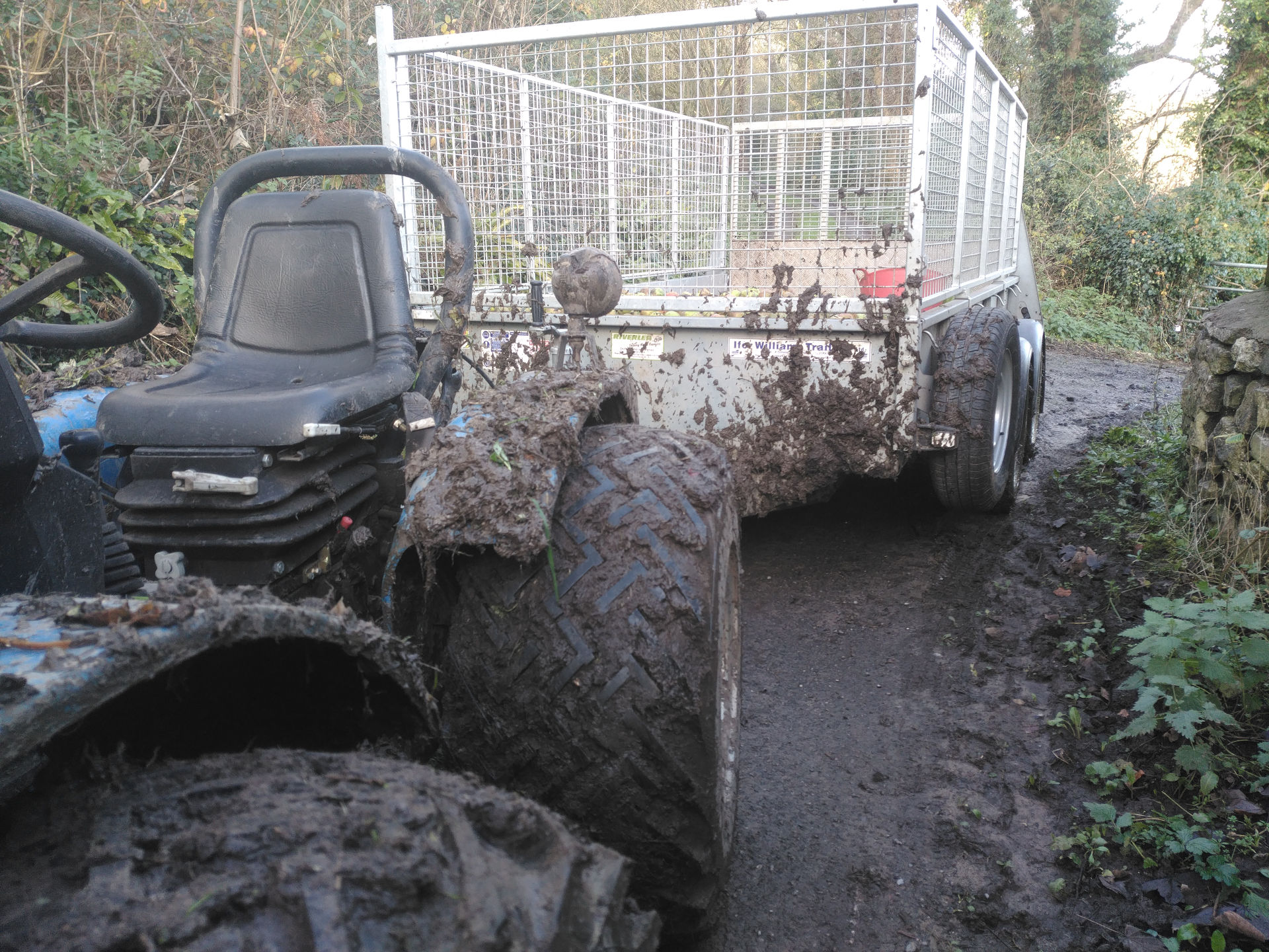 muddy tractor picking