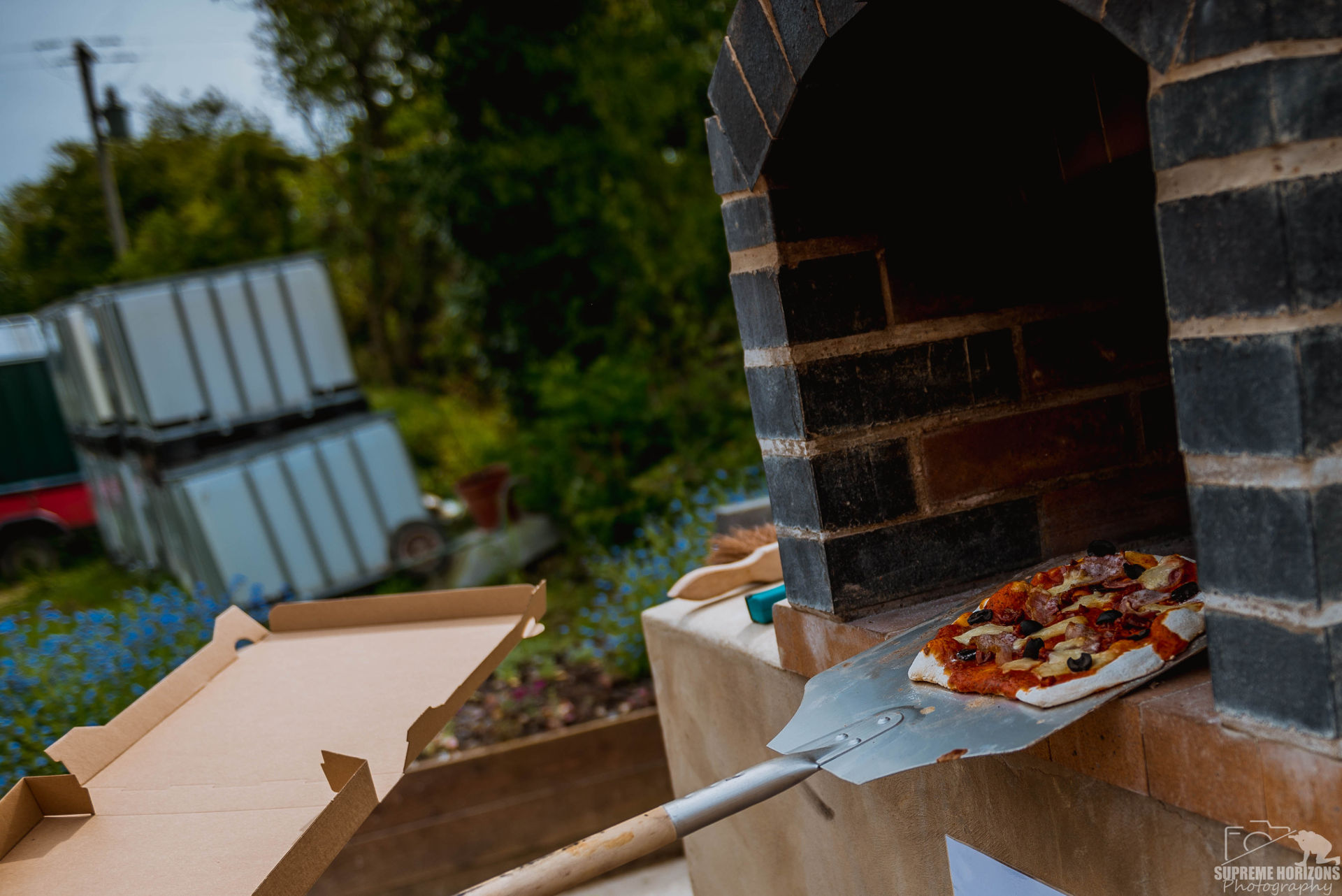 pizza fresh out of oven at llanblethian orchards cider barn south wales